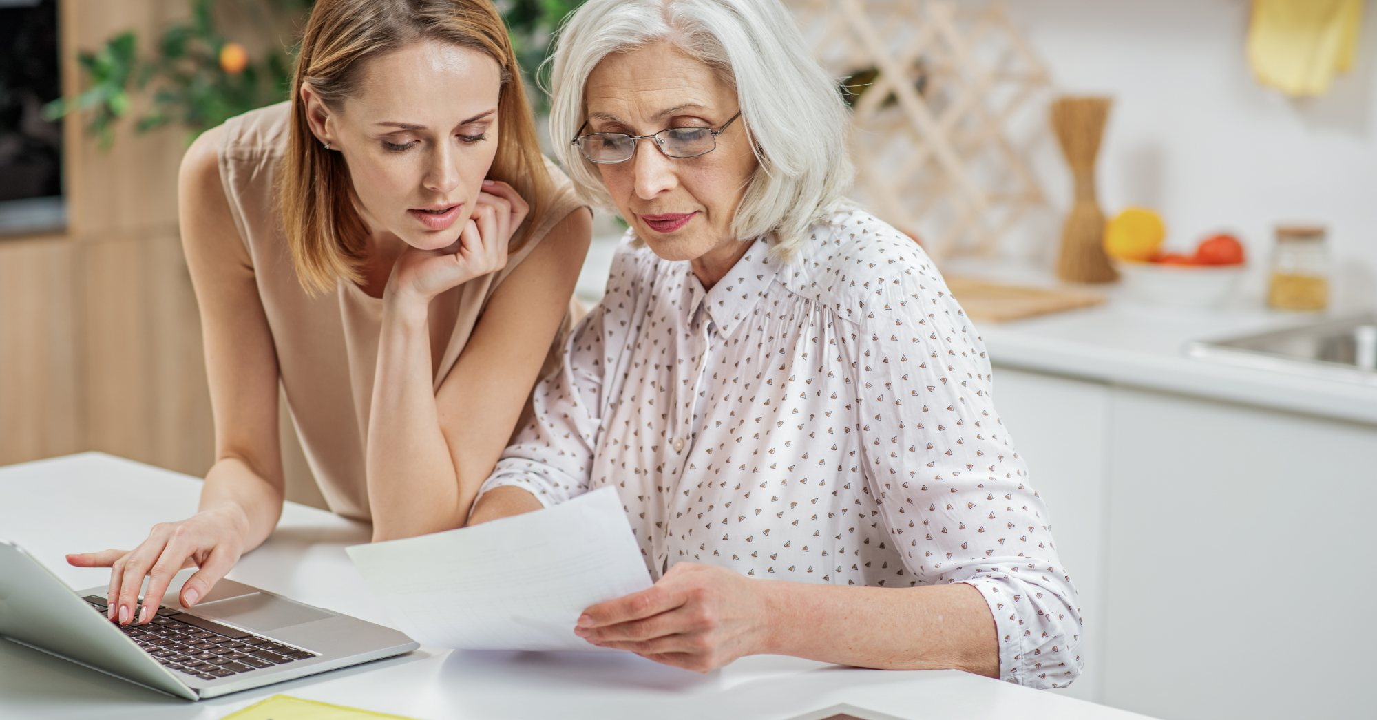 How to Talk to Your Aging Parents About Money - mother and daughter at table – Birchwood